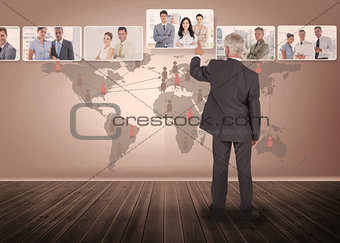 Businessman selecting digital interface with map on background