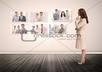 Businesswoman staring at digital interface