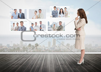 Businesswoman staring at futuristic interface
