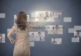 Businesswoman selecting digital interface