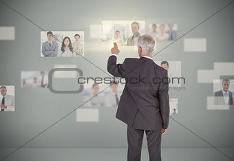 Classy businessman selecting futuristic interface