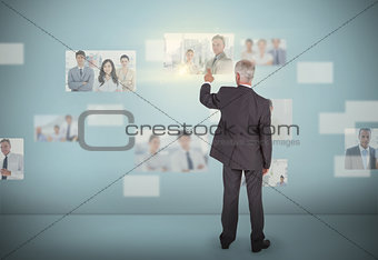 Stylish businessman selecting futuristic interface