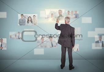 Stylish businessman selecting futuristic interface