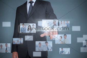 Businessman showing futuristic interface