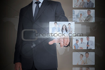 Classy businessman selecting digital interface