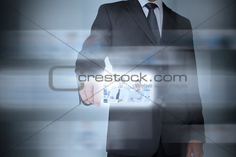 Stylish businessman using futuristic interface