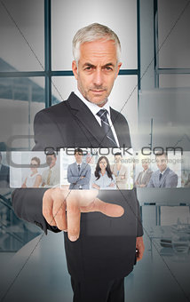 Mature businessman using futuristic interface
