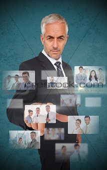 Mature stylish businessman using futuristic interface