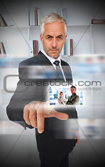 Experienced businessman using futuristic interface