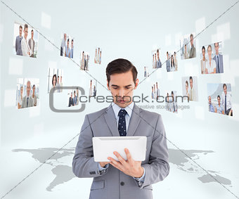 Businessman holding tablet encircled by digital interface
