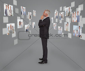 Mature businessman looking at digital interface