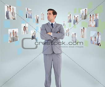 Handsome businessman looking at digital interface