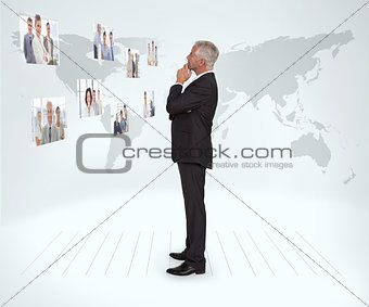 Experienced businessman staring at futuristic interface