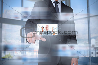 Classy businessman in bright office presenting digital interface