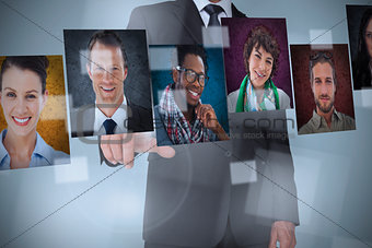 Businessman presenting profile pictures