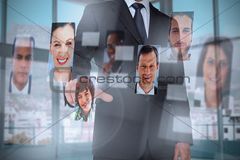 Classy businessman presenting profile pictures
