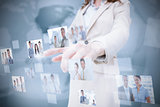 Stylish businesswoman presenting coworkers pictures