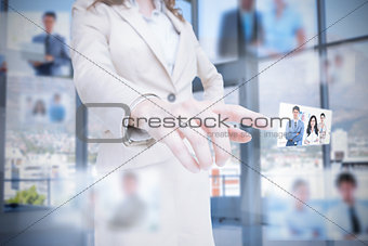 Classy businesswoman presenting coworkers pictures