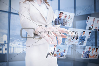 Businesswoman presenting partners pictures