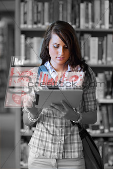Cute student working on her digital tablet computer