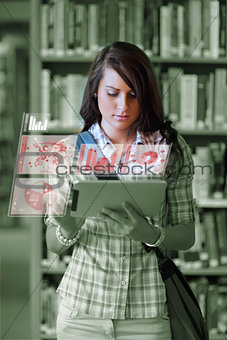Cute student working on her digital tablet pc