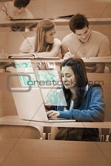 Pretty brunette studying on her futuristic computer