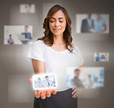 Businesswoman presenting picture of coworkers