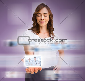 Classy businesswoman presenting picture of coworkers