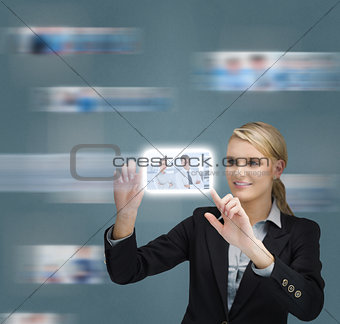 Blonde businesswoman touching digital interface