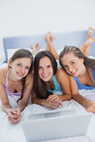 Girls on bed with laptop