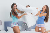 Friends having pillow fight
