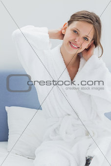 Attractive woman sitting on bed