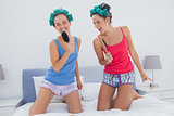Girls having fun wearing pajama and hair rollers