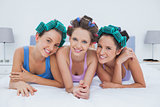 Girls in hair rollers lying in bed