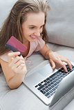 Woman shopping online on the sofa