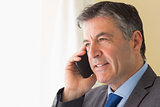 Concentrated man calling someone with his mobile phone