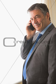 Content man calling someone with his mobile phone