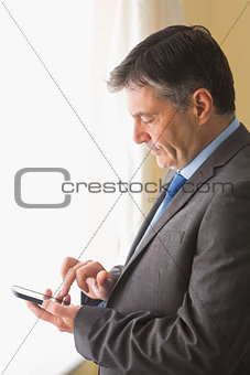 Focused man texting on his mobile phone