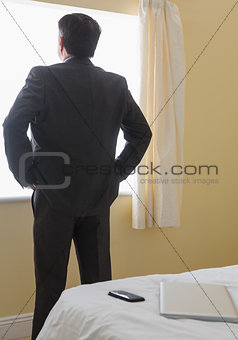 Man standing in front of window