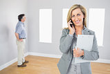 Happy realtor calling someone with her mobile phone