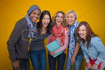 Cheerful group of friends laughing together