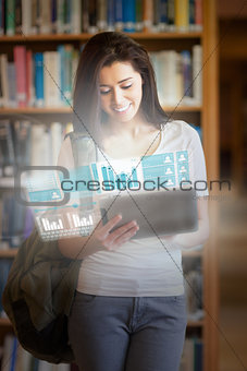 Smiling pretty student working on her futuristic tablet