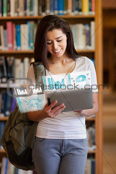 Happy pretty student working on her futuristic tablet