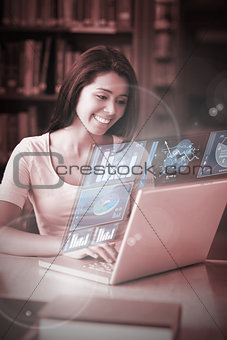 Cheerful student analysing graphs on her digital laptop