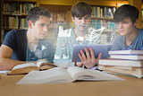 Concentrated young men studying medicine together with futuristic interface