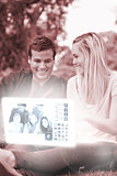 Cheerful young couple watching photos on digital interface