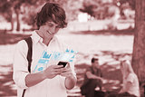 Happy student using his digital smartphone