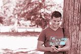 Happy handsome student using his digital smartphone