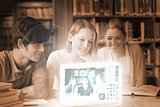 Smiling college friends watching photos on digital interface