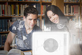 Smiling college friends studying on digital interface